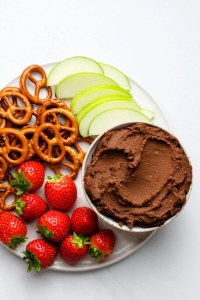 Strawberries, apples and pretzels are three of our favorite snacks to dip in these delicious chocolate hummus!