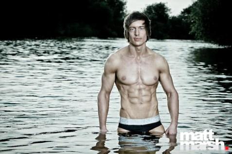 Alexander Hughes posing in water
