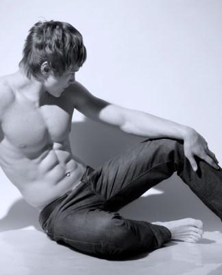 Fitness model sitting on the floor