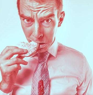 six food hacks for six pack abs, man eating doughnut