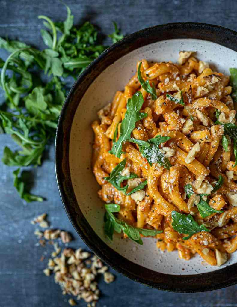Creamy Roasted Red Pepper Pasta with Walnuts in Bowl