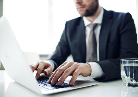private investigator on computer