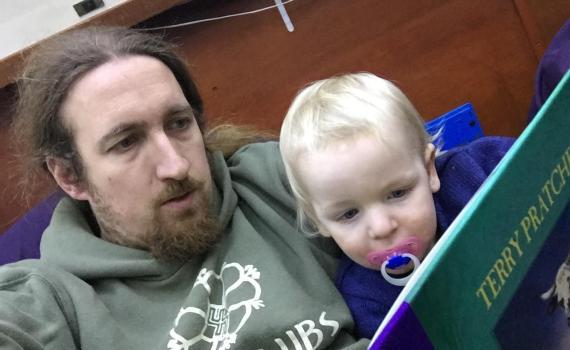 MiniBoyGeek and I reading a book
