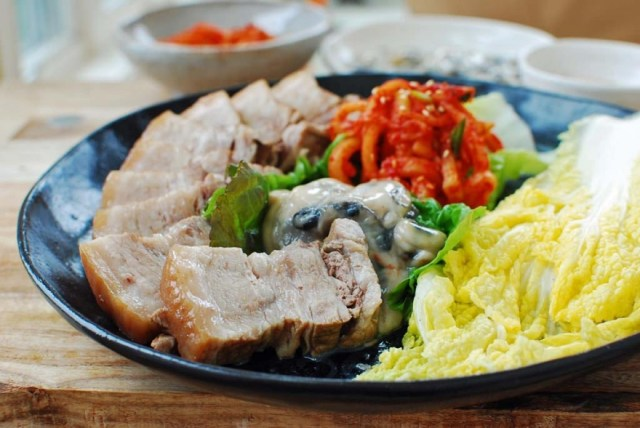 After Kimjang is over, Koreans usually enjoy Bossam. It's a rather simple dish made up of freshly-made Kimchi, raw oysters, and boiled pork. | Skip The Flip