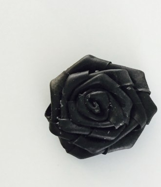 Inner tube rose. I don't recommend trying this unless you like glue all over the finished product. And your hands. And the table. And the cat.
