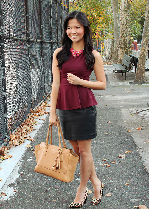 Jenny in Jacquard; NYC fashion blogger; style blog; outfit photo; Topshop oxblood maroon burgundy peplum top; Express black faux leather skirt; David Aubrey necklace; DVF Diane von Furstenberg leopard April heels; Coach Candace carryall tote in camel