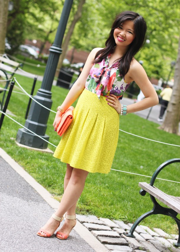 Skirt The Rules Blog; NYC fashion blogger; style blog; spring outfit photo; J.Crew floral print pussybow blouse; Anthropologie neon chartreuse lace skirt; J.Crew Factory neon rose clutch; J.Crew turquoise stretch bracelet; A Beautiful Heart white bubblegum bracelet; BaubleBar arrow cuff; Michael Kors gold boyfriend watch; Sam Edelman colorblock wedge; Essie DJ Play That Song neon purple nail polish
