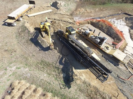 Horizontal Directional Drill- note the steel rod penetrating into the ground just to the right of the excavator as it goes under Rt. 50