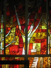 Fall season in stained glass along the chapel wall.