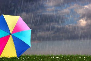13251888 - rainbow colored umbrella s in heavy rain to use as background