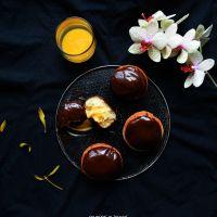 Pączki z ajerkoniakiem oblane gorzką czekoladą