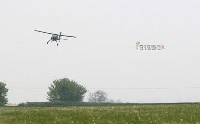 Adams' light aircraft towing the UKIP banner