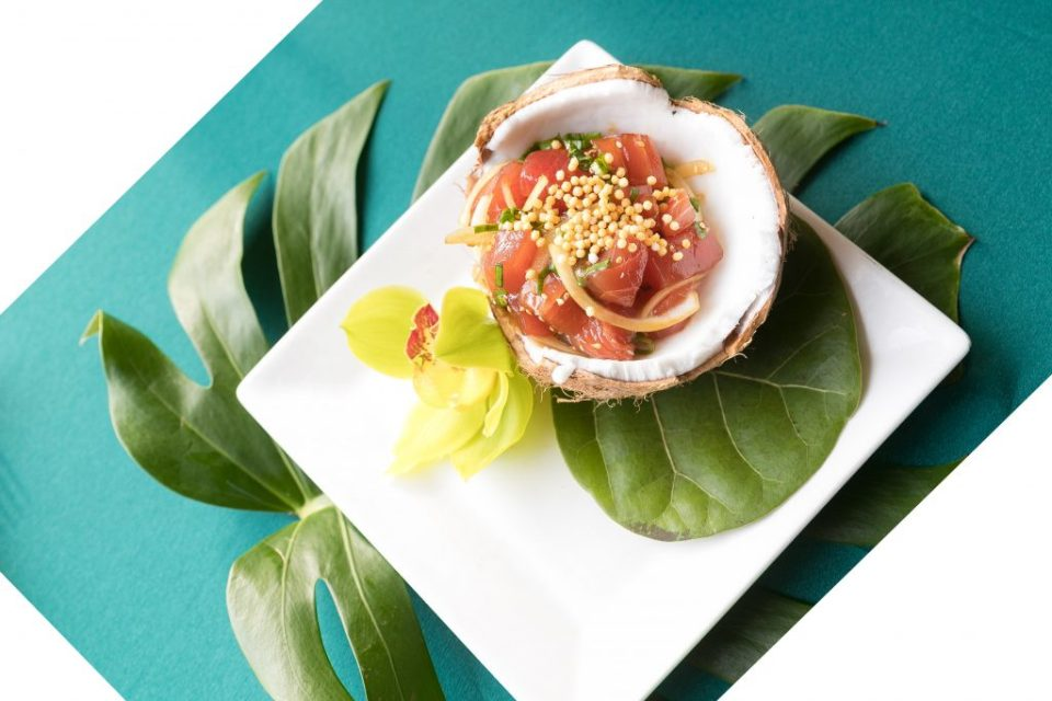 tuna poke in coconut with leaf and orchid Haliewa joes menu