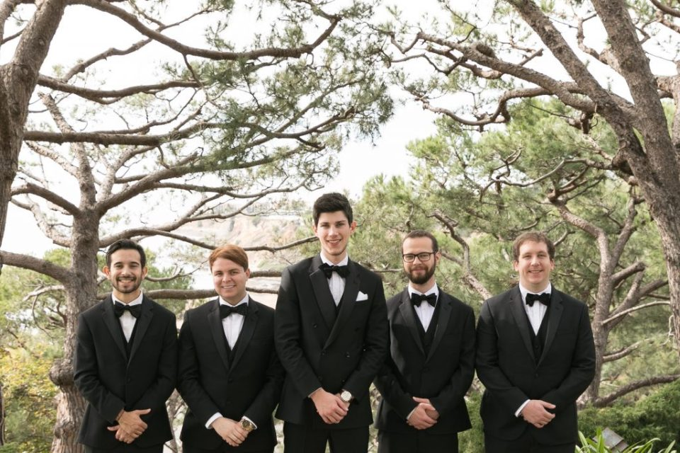 close up of groomsmen trees in background