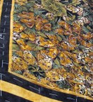 Detail of Jenny's latest kaleidoscope quilt, using a print featuring big cats!