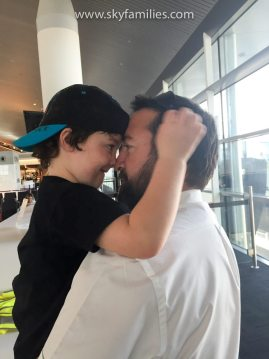 Pilot and Son Share a Moment at the Airport on Fathers Day
