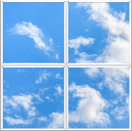 Four window panels with blue sky and wispy white clouds to create artificial sunlight