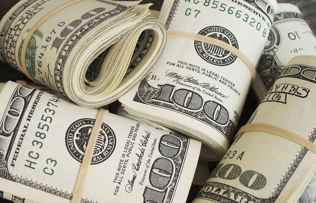 Several rolls of $100 bills.