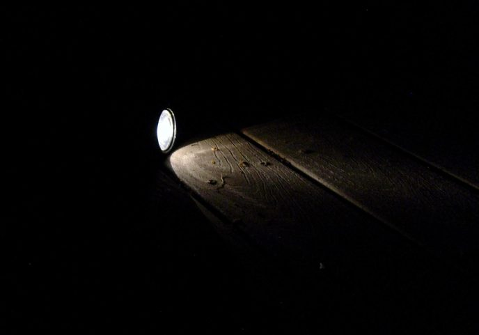 An image of a flashlight shining in a dark room.