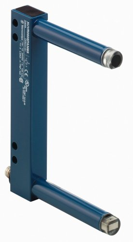 """A photoelectric """"fork"""" sensor built by Telemecanique. This sensor integrates the emitter and receiver on opposing posts on the same frame. The fork sensor's design eliminates the need to install and align separate emitter and receiver modules."""