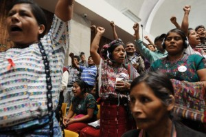 People stand up in Courtroom