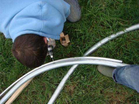 I like to be helpful so here is my foot stabilizing the pipe as Aaron attaches the channel for the wiggle wire.
