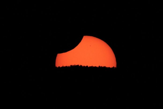 The Sun experienced an annular eclipse as it set a little west of Cedar City, Utah, on May 20, 2012. This image is of its partial phase.| SkyNews