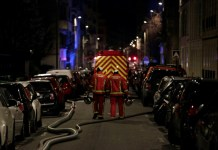 """Seven people died and another was seriously injured in a fire which ripped through a building in a wealthy Paris neighbourhood on Monday night, the fire service said. The blaze in the French capital's trendy 16th arrondissement also left 27 people -- including three firefighters -- with minor injuries. """"The toll could still increase because the fire is still in progress on the 7th and 8th floors"""" of the eight-storey block, fire service spokesman Captain Clement Cognon told AFP at the scene. Described by firefighters as a """"scene of incredible violence"""", the blaze started at about 1:00 am (0000 GMT). Its cause is so far unknown. AFP / AFP Map locating a building blaze in Paris where seven people have died overnight Monday Some of those affected scrambled on to nearby roofs to escape the smoke and flames, and needed to be rescued by fire crews. With landmarks including the Trocadero overlooking the Eiffel Tower, Paris Saint-Germain's home stadium the Parc des Princes, the picturesque Bois de Bologne and an array of upmarket shops and restaurants, the area in the capital's southwest is popular with tourists. Captain Cognon added: """"We had to carry out many rescues, including some people who had taken refuge on the roofs. Thirty people were evacuated on ladders."""" At approximately 5:00 am (0400 GMT), fire crews had finished evacuating the block on rue Erlanger but were still fighting the flames. Two adjacent buildings were also evacuated as a precaution and local officials were on site to help find housing for residents who could not go back to their homes. Around 200 firefighters were still at the scene in the early hours of Tuesday, battling the blaze and treating the injured. AFP / Geoffroy VAN DER HASSELT Around 200 firefighters were still at the scene in the early hours of Tuesday, battling the blaze and treating the injured Several streets of the chic neighbourhood were cordoned off by police and fire crews, and an AFP journalist said a strong smell of smoke was in t"""