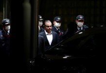 Ghosn wins bail in Japan but banned from seeing wife