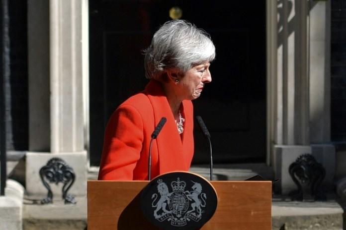 Theresa May bows to pressure