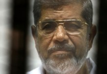 Egypt former president Morsi dies after falling ill in court