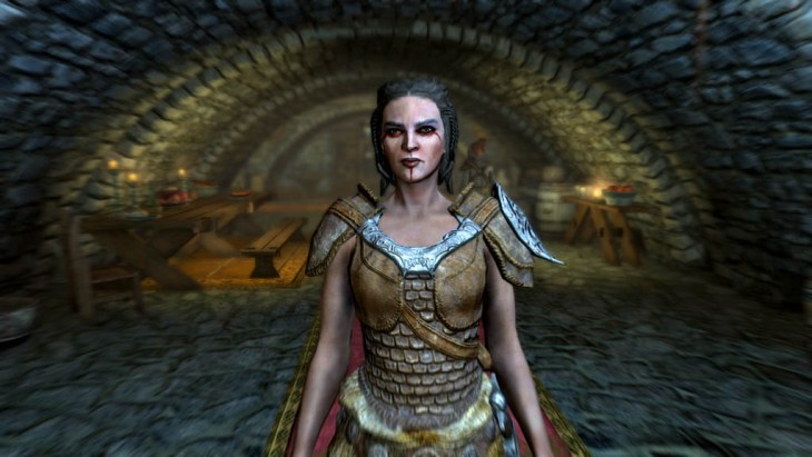 Ria, a member of the Companions, in the Jorrvaskr Living Quarters in Whiterun in Skyrim.