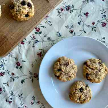 Oatmeal raisin cookies on a plate and a chopping board