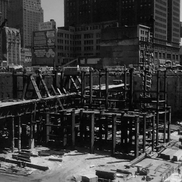Photograph of steelwork of the underground section of the World Trade Center block under construction.