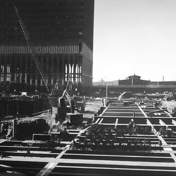 Photograph of the laying of floor plate steel beams at the World Trade Center block under construction.