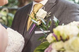 gold and purple boutonniere