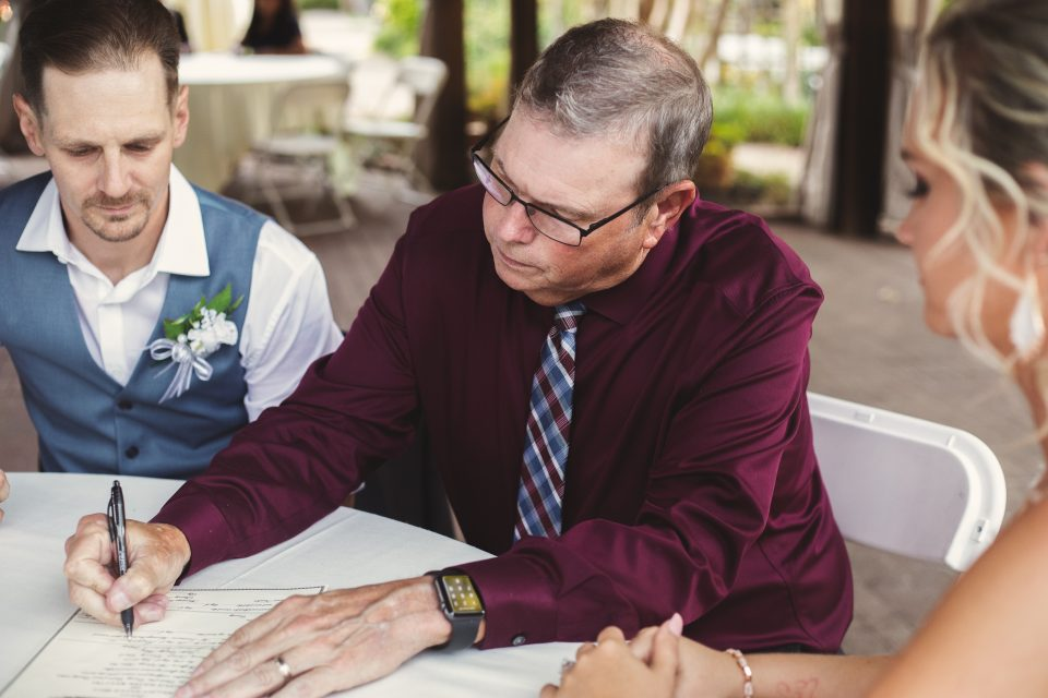 Officiant signing wedding license | Chapel at Chestnut Square in McKinney | Skys the Limit Production