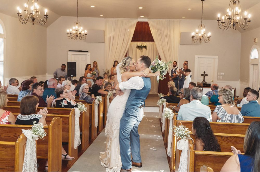 Bride and groom kissing after ceremony | chapel at chestnut square in McKinney, TX | Skys the Limit Production