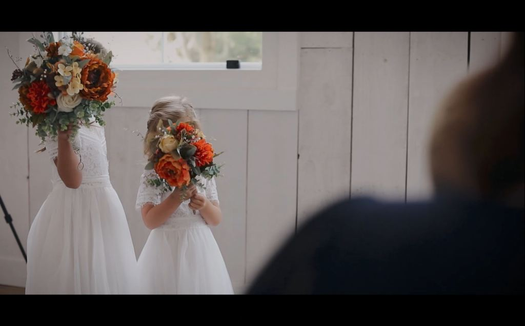 Flower girls during wedding ceremony at the SPRINGS Event venue in Wallisville, Texas | Skys the Limit Production