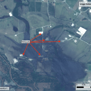 Site 3. Multiple flooded drilling sites approximately 1 to 1.25 miles west of Dreyer. The color of the floodwaters here suggests a possible oil or chemical spill.