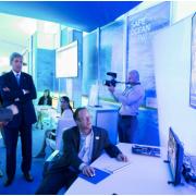 U.S. Secretary of State John Kerry looks on as Paul Woods, SkyTruth CTO, demonstrates the Global Fishing Watch interface. Credit: Franz Mahr, Oceana