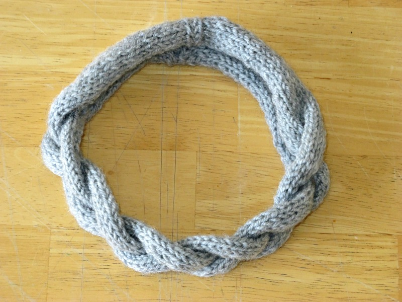 hand knitted braided headband in grey