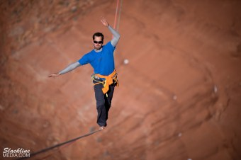 Antony Newton making giant strides across 1,617 feet of a one-inch-wide piece of webbing.