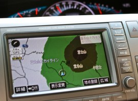 This is a blurry shot of the satellite navigation system in our Toyota Estima minivan showing Mount Fuji. Green terrain is high, dark brown is higher and black is crazy high.