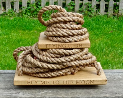 solid oak traditional swing with fly me to the moon, let me play among the stars engraved along each edge and a monkey swing with flying high engraved on the front edge.