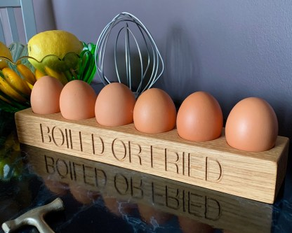 6 egg rack in solid oak engraved with boiled or fried along the front edge