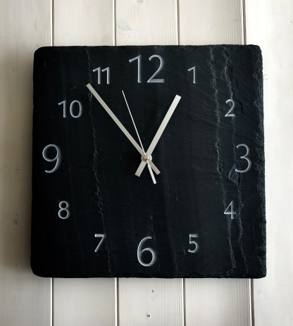 square welsh grey slate clock, with visible surface graining, engraved with a full face of numbers