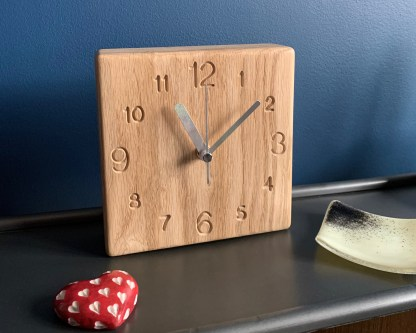 solid oak square clock with a full face of engraved numbers
