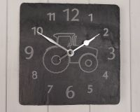 square welsh grey slate clock with engraved numbers and an engraved image of a tractor in the centre