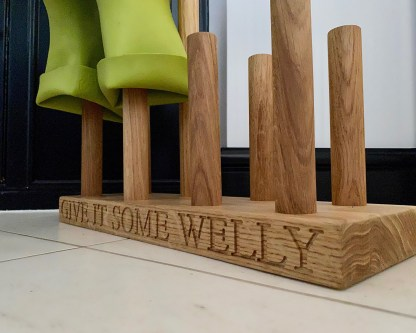profile of solid oak welly boot stand close up on engraving give it some welly